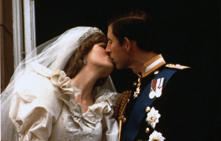 2012-08-28-2-prince-charles-kisses-his-new-bride-diana-on-their-wedding-day-july-29-1981